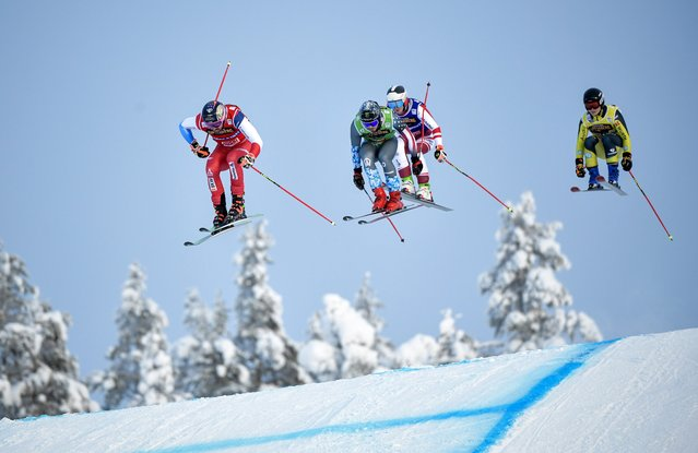 (L-R) Ryan Regez of Switzerland, Tyler Wallasch of USA, Sandro Siebenhofer of Austria and Ferdinand Dorsch of Germany during the men's quarterfinal heat 4 during the men's Ski Cross final at the FIS Freestyle Ski World Cup event in Idre, Sweden 23 January 2021. (Photo by Pontus Lundahl/EPA/EFE)