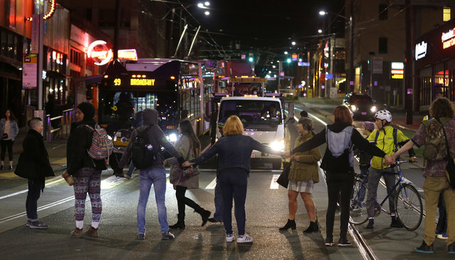 Protesters block a street and stop traffic during a demonstration against President-elect Donald Trump, early Wednesday, November 9, 2016, in Seattle's Capitol Hill neighborhood. (Photo by Ted S. Warren/AP Photo)