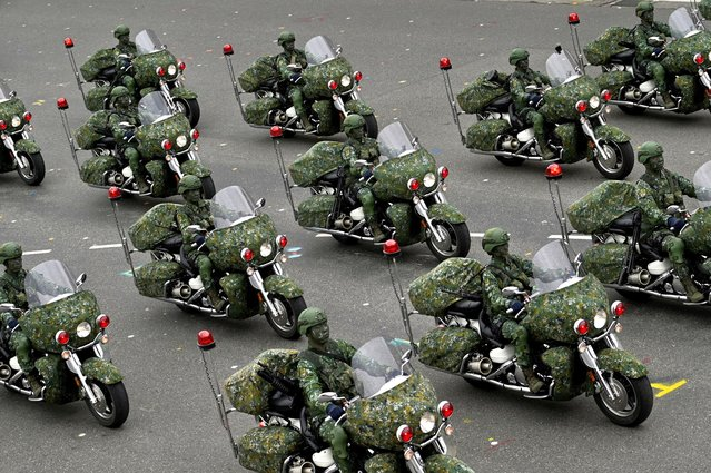 Taiwan's military police perform during the National Day in front of the Presidential Office in Taipei on October 10, 2020. (Photo by Sam Yeh/AFP Photo)