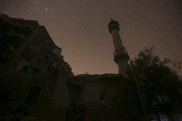 A damaged mosque is pictured at night in Aleppo, Syria December 11, 2015. (Photo by Ammar Abdullah/Reuters)
