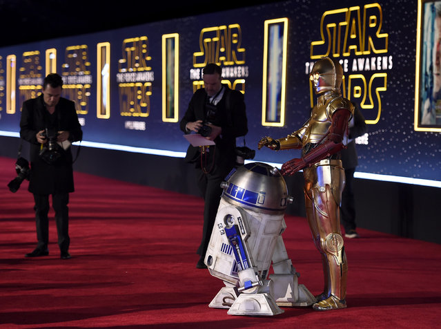 "Film characters R2-D2, left, and C-3PO arrive at the world premiere of ""Star Wars: The Force Awakens"" at the TCL Chinese Theatre on Monday, December 14, 2015, in Los Angeles. (Photo by Jordan Strauss/Invision/AP Photo)"