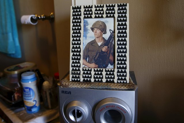 A photograph is seen in a home at Quixote Village in Olympia, Washington October 11, 2015. Quixote Village is made up of 30 cottages, a community building with a kitchen, showers and laundry facilities and a vegetable garden. At homeless encampments from Seattle, Washington state to Las Cruces, New Mexico, residents live away from the dangers of life on the streets, saying the stability helps them work towards their goals. (Photo by Shannon Stapleton/Reuters)