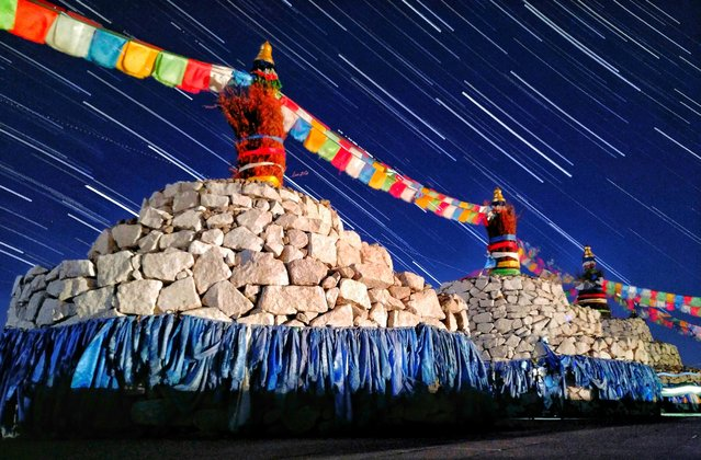 Taken during a summer night in Mingantu in Inner Mongolia, star trails are sweeping over the colourful and extraordinary sacred altars, called Ovoo. (Photo by Qiqige Zhao/Astronomy Photographer of the Year 2018)
