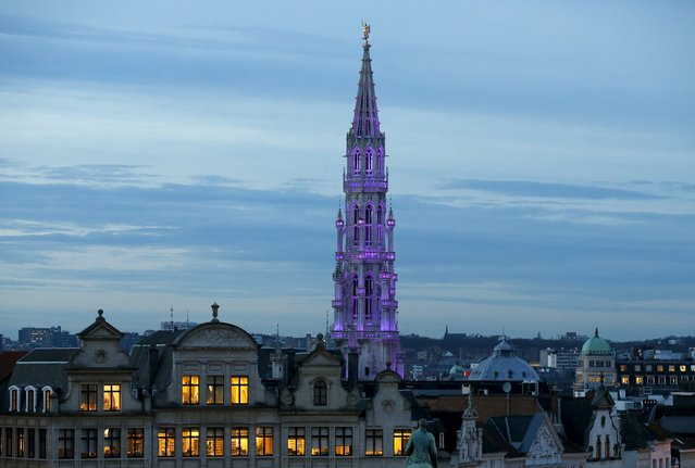 The city hall on Brussels' Grand Place is illuminated during a light show, December 30, 2015. (Photo by Francois Lenoir/Reuters)