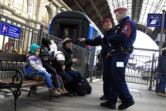 Hungarian policemen check the documents of Kosovars in Keleti (Eastern) railway station in Budapest, February 10, 2015. The European Union is experiencing a steep rise in the number of Kosovo citizens smuggling themselves into the affluent bloc, with 10,000 filing for asylum in Hungary in just one month this year compared to 6,000 for the whole of 2013. (Photo by Bernadett Szabo/Reuters)