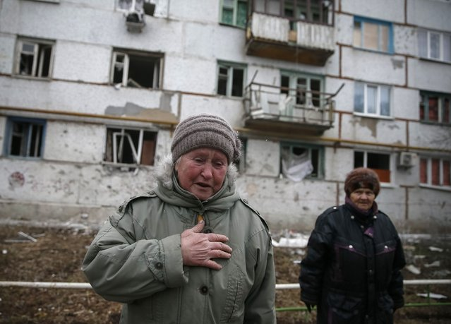 Local residents react near their home after shelling in recent days in Svitlodarsk, eastern Ukraine, February 15, 2015. (Photo by Gleb Garanich/Reuters)