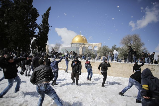 Palestinians throw snowballs at each other after Friday prayers near the Dome of the Rock on the compound known to Muslims as Noble Sanctuary and to Jews as Temple Mount, in Jerusalem's Old City February 20, 2015. (Photo by Ammar Awad/Reuters)