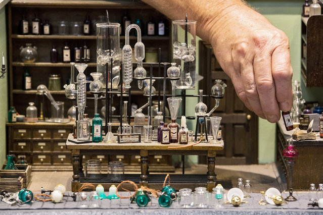 A miniature apothecary set on display at the Miniatura - Dolls' House and Miniatures show at the National Exhibition Centre in Birmingham, England on Sunday, September 23, 2018. (Photo by Aaron Chown/PA Wire)