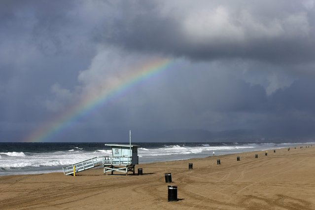 A rainbow is seen from the Manhattan Beach pier during heavy rains in Manhattan Beach, California, December 12, 2014. TThe National Weather Service forecast the system to track through southwestern California late on Thursday and into Friday, bringing the possibility of strong thunderstorms, as well as waterspouts and small tornadoes along the coast. (Photo by Patrick T. Fallon/Reuters)