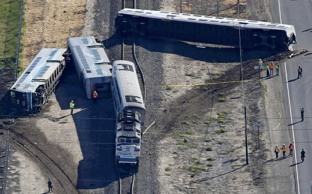 An aerial view shows the scene of a double-decker Metrolink train derailment in Oxnard, California February 24, 2015. (Photo by Lucy Nicholson/Reuters)