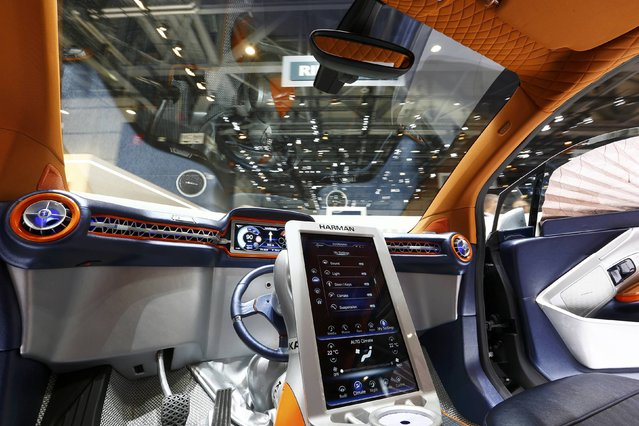 The steering wheel is seen resting in the middle of the dashboard inside a Rinspeed Budii self-driving electric city car during the second press day ahead of the 85th International Motor Show in Geneva March 4, 2015. Mounted on a swivelling motorised arm the steering wheel can be used to drive from either side of the car.  REUTERS