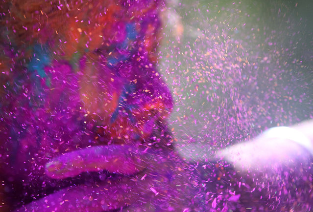 A man smears the face of a woman with coloured powder during celebrations marking Holi, the Hindu festival of colors, in Mumbai, India, Friday, March 6, 2015. Holi, India's joyful and colorful celebration of the arrival of spring along with several religious myths and legends, has long ago ceased to be only a Hindu festival. The streets and lanes across most of India turn into a large playground where people off all faiths throw colored powder and water at each other. (AP Photo/Rajanish Kakade)