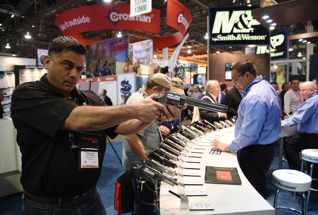 Rene Ramirez checks out a model S&W500 handgun at the Smith & Wesson booth during the 2016 National Shooting Sports Foundation's Shooting, Hunting, Outdoor Trade (SHOT) Show at the Sands Expo and Convention Center on January 19, 2016 in Las Vegas, Nevada. (Photo by Ethan Miller/Getty Images)