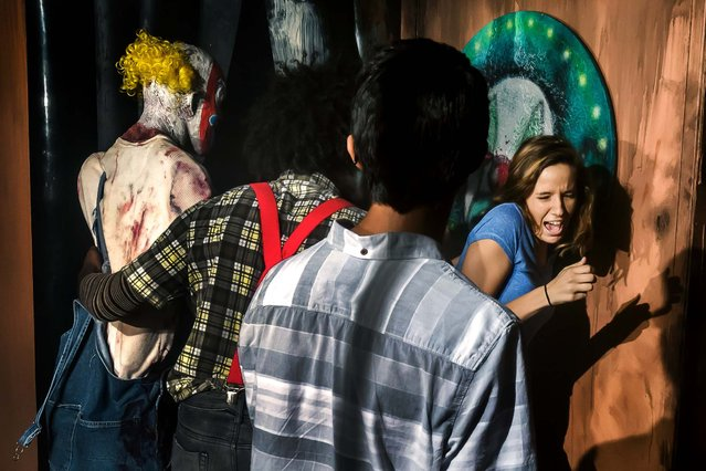 Fright Nights attendees make a turn through one of four haunted houses at this year's spooking season setup at the South Florida Fairgrounds. This house is named The Smiths and was created by Craig McInnis.