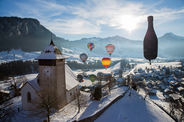 Hot air balloons take part in the 38th International Balloon Festival of Chateau-d'oex, Switzerland, 23 January 2016. The festival takes place from 23 to 31 January. (Photo by Cyril Zingaro/EPA)