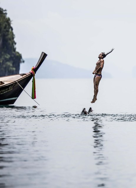 In this handout image provided by Red Bull, Orlando Duque of Colombia prepares for his water entry after diving from the 27 metre platform at training on Hong Island in the Andaman Sea during the final stop of the 2013 Red Bull Cliff Diving World Series on October 25, 2013 at Krabi, Thailand. (Photo by Dean Treml/Red Bull via Getty Images)