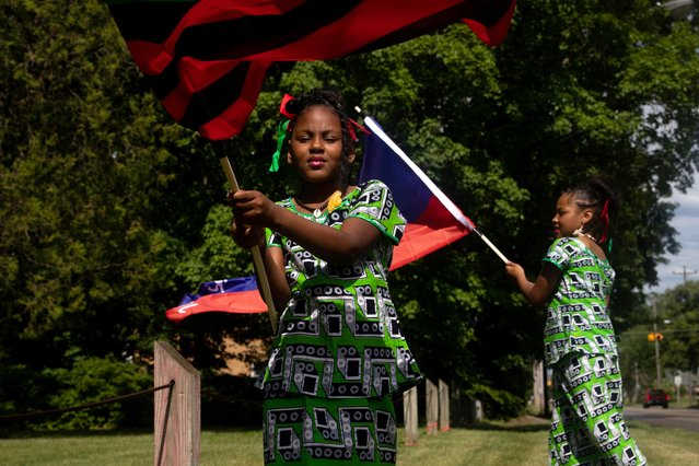 People celebrate Juneteenth, which commemorates the end of slavery in Texas, two years after the 1863 Emancipation Proclamation freed slaves elsewhere in the United States, in Flint, Michigan, U.S., June 19, 2021. (Photo by Emily Elconin/Reuters)