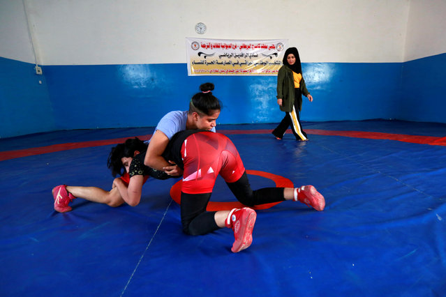 Iraqi women wrestle during practice at the sports club in Diwaniya, Iraq on November 10, 2018. (Photo by Alaa Al-Marjani/Reuters)