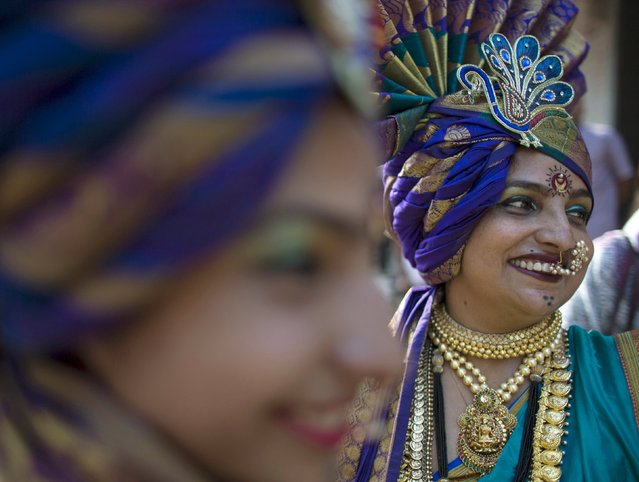 Maharashtrian women dressed in traditional costumes attend celebrations to mark the Gudi Padwa festival in Mumbai March 21, 2015. (Photo by Danish Siddiqui/Reuters)
