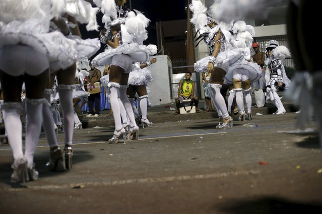 Revellers of the Sao Clemente samba school wait to participate during the carnival parade at the Sambadrome in Rio de Janeiro, February 8, 2016. (Photo by Ricardo Moraes/Reuters)