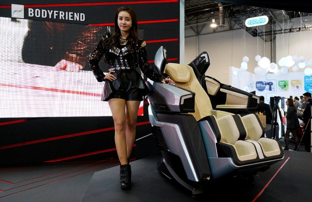 A woman poses with the South Korean company Bodyfriend massage chair at CES in Las Vegas, U.S., January 5, 2017. (Photo by Rick Wilking/Reuters)