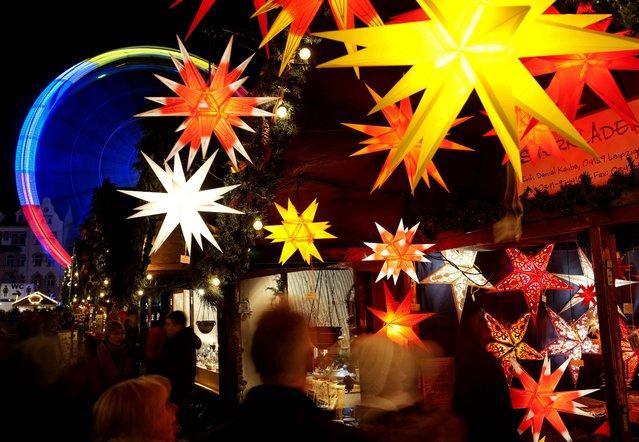 People walk along the Christmas Fair in Erfurt, Germany. (Photo by Jens Meyer/Associated Press)