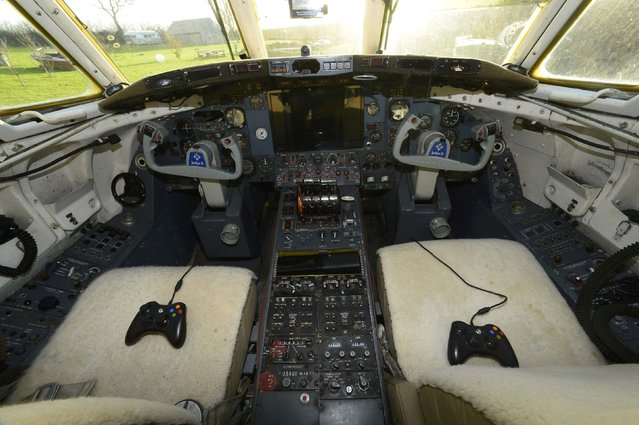 Video game controllers are seen in the cockpit of a luxury Jetstar private jet, built in the seventies and retaining most of the original features which is now being used as a holiday let in Redberth, Pembrokeshire, Wales, January 11, 2017. (Photo by Rebecca Naden/Reuters)