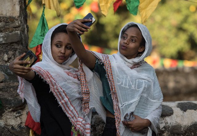 Women pose for a selfie photograph during the annual Timkat epiphany celebration on January 18, 2017 in Gondar, Ethiopia. (Photo by Carl Court/Getty Images)