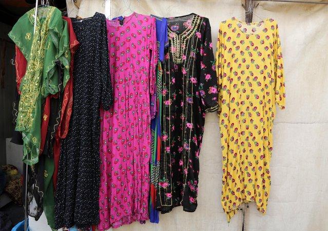 In this April 16, 2015 photo, clothes on display for sale at al-Aqeeliya open-air auction market in Riyadh, Saudi Arabia. (Photo by Hasan Jamali/AP Photo)