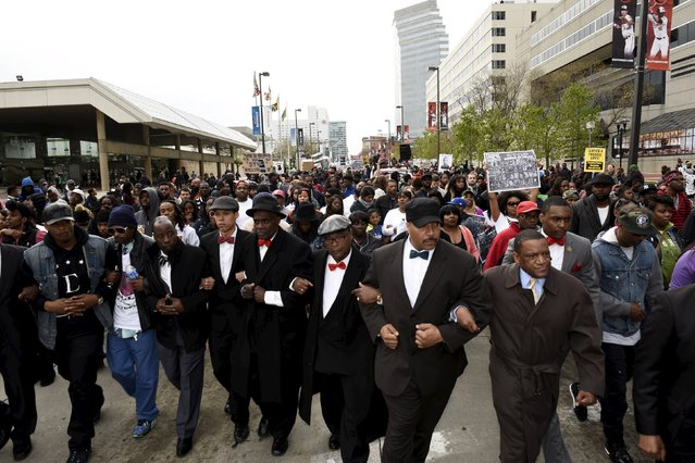Demonstrators march to City Hall to protest against the death of Freddie Gray in police custody, in Baltimore April 25, 2015. (Photo by Sait Serkan Gurbuz/Reuters)
