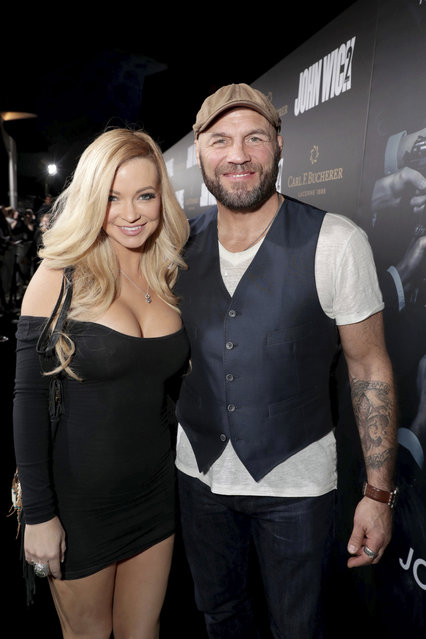 """Mindy Robinson and Randy Couture seen at Summit Entertainment, a Lionsgate Company, Los Angeles Premiere of """"John Wick Chapter 2"""" at ArcLight Hollywood on Monday, January 30, 2017, in Los Angeles. (Photo by Eric Charbonneau/Invision for Lionsgate/AP Images)"""