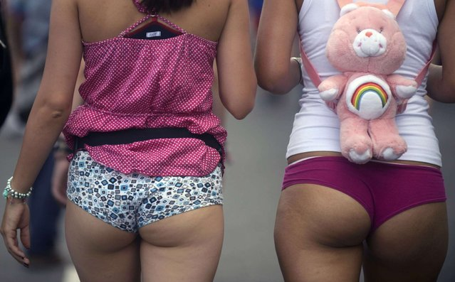 "People walk without pants along a street during the ""Day Without Pants"" in Medelin, Antioquia department, Colombia on February 9, 2014. (Photo by Raúl Arboleda/AFP Photo)"