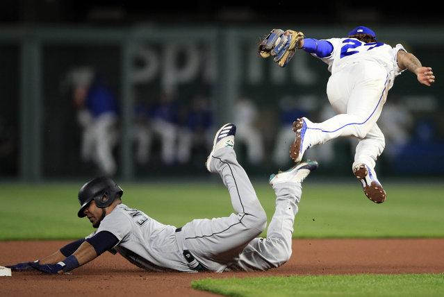 Kansas City Royals shortstop Adalberto Mondesi, right, tags out Seattle Mariners' Edwin Encarnacion, left, during the fourth inning of a baseball game at Kauffman Stadium in Kansas City, Mo., Monday, April 8, 2019. (Photo by Orlin Wagner/AP Photo)