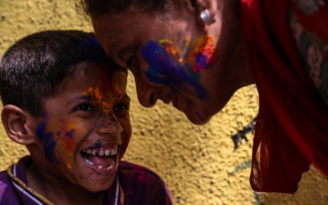 Physically and mentally disabled Indian children have their faces smeared with powdered colours during the Holi festival celebrations at the special school 'Society for the Education of the Crippled' in Mumbai, India, 23 March 2016. Holi festival is celebrated on the full moon day and marks the beginning of the spring season. (Photo by Divyakant Solanki/EPA)