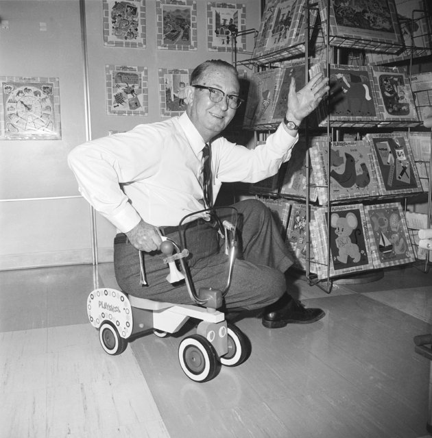 """Jarvis (Jerry) Rockwell, 75, shown on his """"Tyke Truck"""" in Chicago on February 7, 1967 , which is a modernized version of the kiddie car produced generations ago. Rockwell said his employer, Playskool, sold a million of the kiddie car type toy. A brother of Norman Rockwell, the artist, Rockwell has been designing toys for 36 years. (Photo by AP Photo)"""