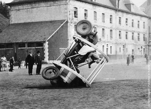 1925: A stunt car being rolled