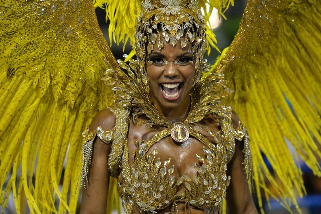 Revelers of the Unidos da Tijuca samba school perform during the second night of carnival parade at the Sambadrome in Rio de Janeiro, Brazil on March 4, 2014. (Photo by  Yasuyoshi Chiba/AFP Photo)