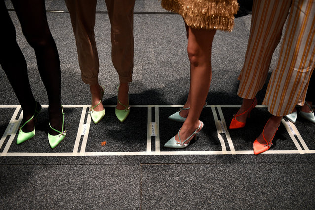 Models prepare backstage ahead of the Alice McCall show during Mercedes-Benz Fashion Week Australia in Sydney, Australia, 14 May 2019. (Photo by Dan Himbrechts/EPA/EFE)