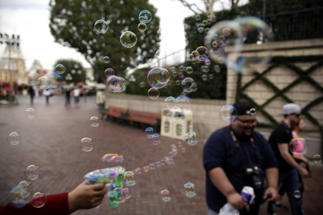 Soap bubble fly at Disneyland, Thursday, January 22, 2015, in Anaheim, Calif. Seventy people have been infected in a measles outbreak that led California public health officials to urge those who haven't been vaccinated against the disease, including children too young to be immunized, should avoid Disney parks where the spread originated. (Photo by Jae C. Hong/AP Photo)