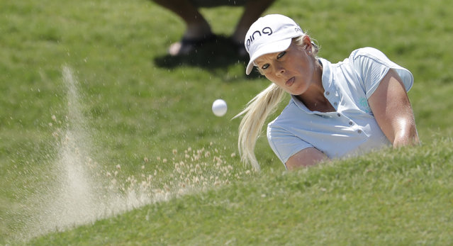 Jacqui Concolino hits out of a bunker on the first hole during the third round of the LPGA Tour golf tournament at Kingsmill Resort in Williamsburg, Va., Saturday, May 25, 2019. (Photo by Steve Helber/AP Photo)