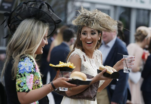 Ladies have food during Ladies Day of the Crabbie's Grand National Festival at Aintree Racecourse on April 8, 2016 in Liverpool, England. (Photo by Andrew Yates/Reuters/Livepic)