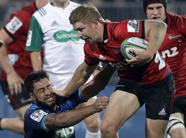 Crusaders Jack Goodhue, right, fends off Blues Akira Ioane during their Super Rugby match in Christchurch, New Zealand, Saturday, May 25, 2019. (Photo by Mark Baker/AP Photo)