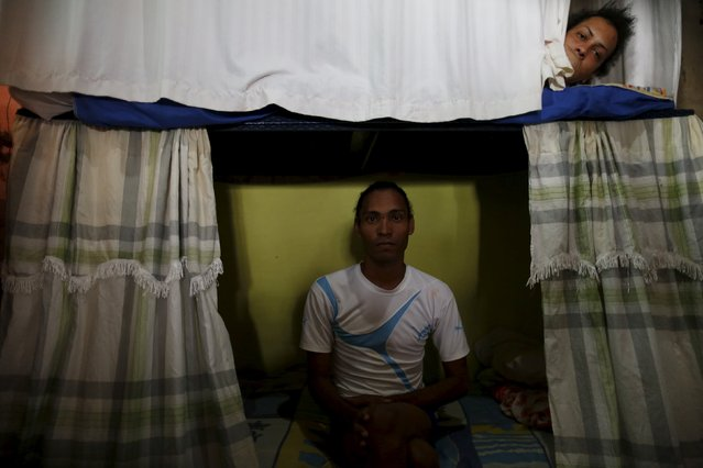 Inmate Alvis Javier (L), poses for a photograph as another prisoner looks from his bunk inside the transgender gallery in La Joya prison on the outskirts of Panama City, Panama January 27, 2016. Javier is still waiting for his sentence after six years in prison. (Photo by Carlos Jasso/Reuters)