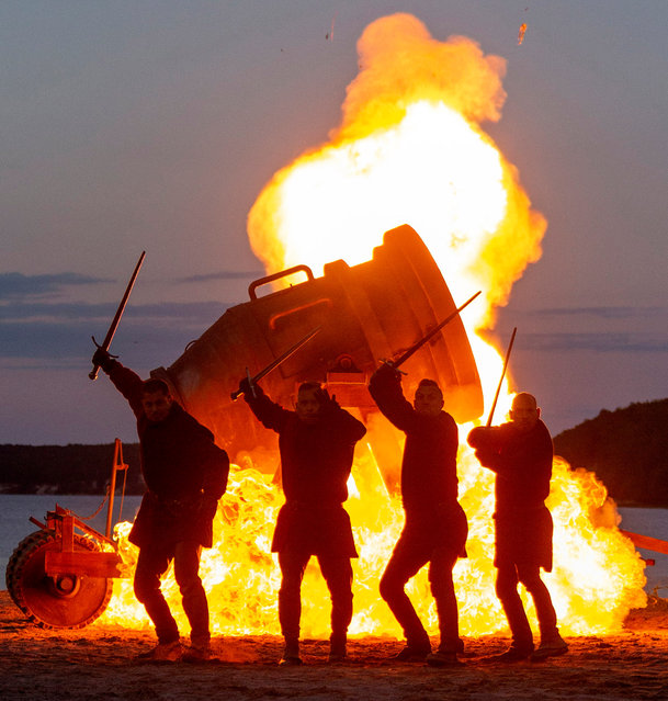 "Stuntmen rehears a fight scene in front of a fireball over big cannon 'Bombarde' on stage of the Stoertebeker Festival in Ralswiek on the island of Ruegen, northern Germany, 08 June 2019 (issued 09 June). The action is set for the play ""Oath of the righteous"". The open-air theater has its premiere on 22 June and tells the legend of the pirate Klaus Stoertebeker. (Photo by Jens Koehler/EPA/EFE)"