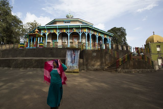 A woman stands near Entoto Maryam church on the outskirts of Addis Ababa, Ethiopia, May 16, 2015. (Photo by Siegfried Modola/Reuters)