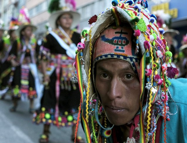 "Thinku dancers perform during the ""Senor del Gran Poder"" (Lord of Great Power) parade in La Paz, May 30, 2015. According to local media, thousands of dancers participated in this annual pagan religious celebration. REUTERS/David Mercado"