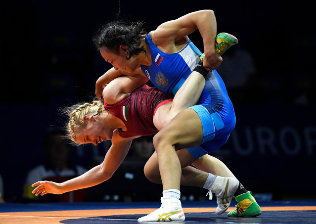 Stalvira Orshush (R) of Russia in action against Mercedesz Denes (L) of Hungary during their bronze medal bout in the women's Wrestling 53kg category of the Minsk 2019 European Games at the Sports Palace in Minsk, Belarus, 27 June 2019. (Photo by Tamás Kovács/EPA/EFE)