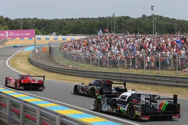 Spectators watch the 83rd 24-hour Le Mans endurance race, in Le Mans, western France, Saturday, June 13, 2015. (AP Photo/David Vincent)