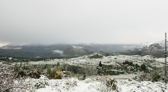 Settled snow is seen covering houses and Cecil Peak on New Zealand's lower South Island