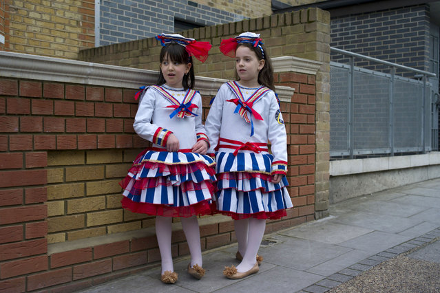 Young Jewish girls stand outside a home during the annual Jewish holiday of Purim on March 12, 2017 in London, England. (Photo by Dan Kitwood/Getty Images)